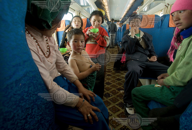 A Tibetan family aboard a train from Beijing to Lhasa.