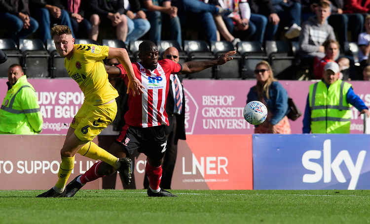 Lincoln City's John Akinde vies for possession with Fleetwood Town's Harry Souttar<br /> <br /> Photographer Chris Vaughan/CameraSport<br /> <br /> The EFL Sky Bet League One - Lincoln City v Fleetwood Town - Saturday 31st August 2019 - Sincil Bank - Lincoln<br /> <br /> World Copyright © 2019 CameraSport. All rights reserved. 43 Linden Ave. Countesthorpe. Leicester. England. LE8 5PG - Tel: +44 (0) 116 277 4147 - admin@camerasport.com - www.camerasport.com