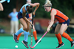 12 September 2014: Syracuse's Serra Degnan (right) knocks the ball away from North Carolina's Emily Wold (left). The University of North Carolina Tar Heels hosted the Syracuse University Orange at Francis E. Henry Stadium in Chapel Hill, North Carolina in a 2014 NCAA Division I Field Hockey match. UNC won the game 3-0.