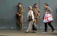 Men in World War I gear outside Swansea Bus Station, south Wales UK. Friday 01 July 2016
