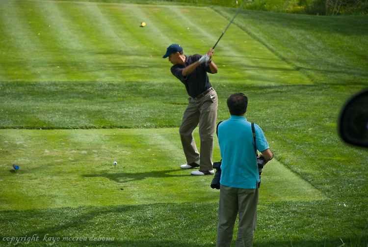 President Obama playing golf on his vacation in Asheville, NC, April 24, 2010