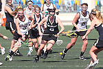 Santa Barbara, CA 02/18/12 - Kendra Keenan  (Cal Poly SLO #3), Avery Toothman (Colorado #5) and Adrian Holland  (Cal Poly SLO #5) in action during the 2012 Santa Barbara Shootout.  Colorado defeated Cal Poly SLO 8-7.