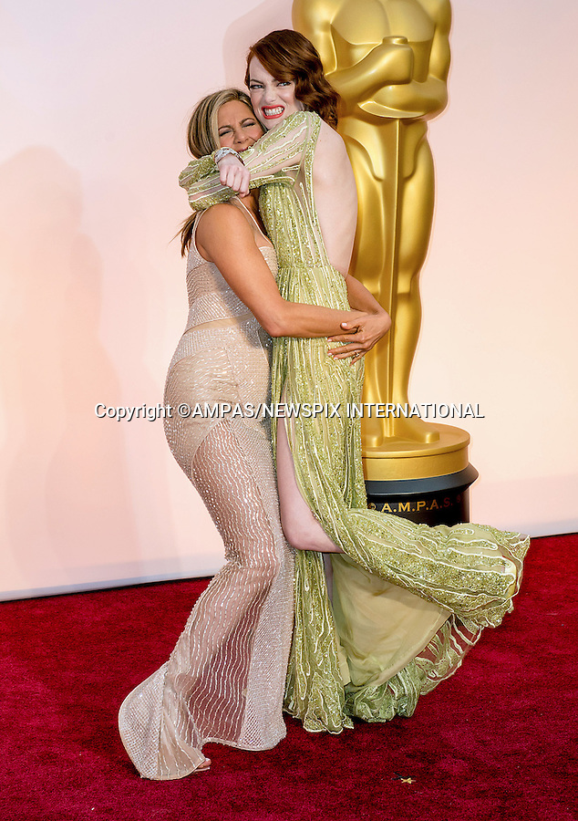 22.02.2015; Hollywood, California: 87TH OSCARS - JENNIFER ANISTON LIFTS EMMA STONE<br /> Celebrity arrivals at the Annual Academy Awards, Dolby Theatre, Hollywood.<br /> Mandatory Photo Credit: NEWSPIX INTERNATIONAL<br /> <br />               **ALL FEES PAYABLE TO: &quot;NEWSPIX INTERNATIONAL&quot;**<br /> <br /> PHOTO CREDIT MANDATORY!!: NEWSPIX INTERNATIONAL(Failure to credit will incur a surcharge of 100% of reproduction fees)<br /> <br /> IMMEDIATE CONFIRMATION OF USAGE REQUIRED:<br /> Newspix International, 31 Chinnery Hill, Bishop's Stortford, ENGLAND CM23 3PS<br /> Tel:+441279 324672  ; Fax: +441279656877<br /> Mobile:  0777568 1153<br /> e-mail: info@newspixinternational.co.uk