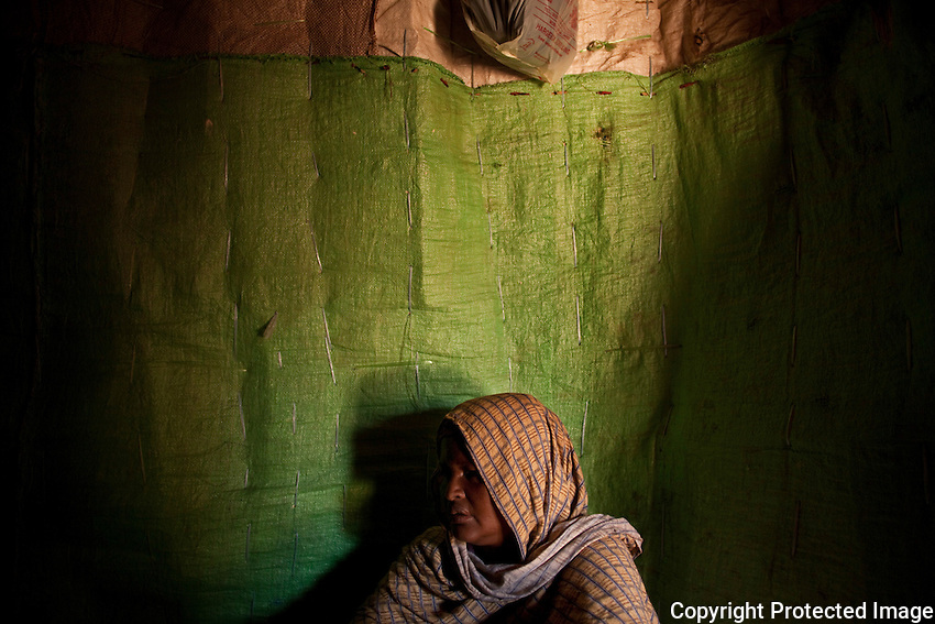 """Halima Bashir Sheikh, a refugee from Mogadishu, currently stays in stae House IDP camp with four of her 8 children...""""I came from Mogadishu  and have been at State House three months. .War and fighting made me leave Mogadishu, it took me ten days to get here, ten days of difficulty.  ..There's been war for some time, but this time it got worse.  As soon as the Ethiopians came - the face of the war changed - there was raping of women and the killing of children. . .I came here by bus.  All the small possessions I had were looted, we were very frightened because we didn't know where we were going or what would happen to us on the way. .I have five children.  I gave birth to eight, but three died in the war. ..I would like the world to know we're living with problems.  We've escaped from a bigger problem - a lack of security.  But now we're also living a desperate life.  I would ask them to help calm down Mogadishu. ..If God wishes, we will see peace in Mogadishu.  But as far as I can see, it's far from settling down.  ..Imagine, you hear the sound of bullets - you don' know where they're coming from and you're running fro your life, this is war.  Many people died, many innocent people.  There's only one place people are living now in Mogadishu - in Medina district - they can live there because insurgents are in the other areas.  I lived in Taleh.  I had a rented house with its own verandah, own toilet and kitchen - it was a big brick house with five rooms.  It was partially destroyed during the war. ..The only feeling I have for the people fighting in Mogadishu is to pray for them.  I will pray for God to restore their minds to normal so they will stop what they are doing.  .Before the war, Mogadishu was very beautiful - there were good businesses, houses.  Now all this is destroyed, no business, people are not living happily because they're worried - this is the picture now.  ...Peace is very sweet.  When my kids leave the house, to go to school or play I can cook fo"""
