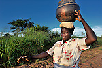 Florence Shawa carries water home from a well in her village of Thundira, in northern Malawi.
