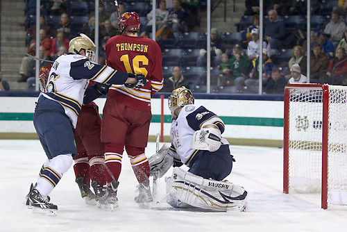 Notre Dame goaltender Mike Johnson (#32) looks to make the save in first period action of NCAA hockey game between Notre Dame and Ferris State.  The Ferris State Bulldogs defeated the Notre Dame Fighting Irish 3-0 in game at the Compton Family Ice Arena in South Bend, Indiana.