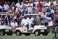 AUSTIN, TX - Michael Irvin and Emmitt Smith of the Dallas Cowboys drive a golf cart during training camp in Austin, Texas in 1997. Photo by Brad Mangin.
