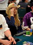 PS Team Pro Vanessa Rousso agonizes over making a call on the river.  She flopped a straight but mucked, fearing her opponent had a better hand.