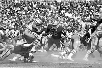 Raiders vs. Chargers : Phill Villapiano and Monte Johnson stop Charger runing back #33. (1976 photo/Ron Riesterer)