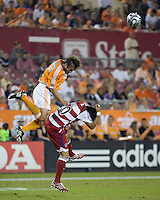 FC Dallas forward Carlos Ruiz and Houston Dynamo defender Eddie Robinson go for a header during the second leg of the Western Conference Semifinal Series at Robertson Stadium in Houston, TX on November 2, 2007