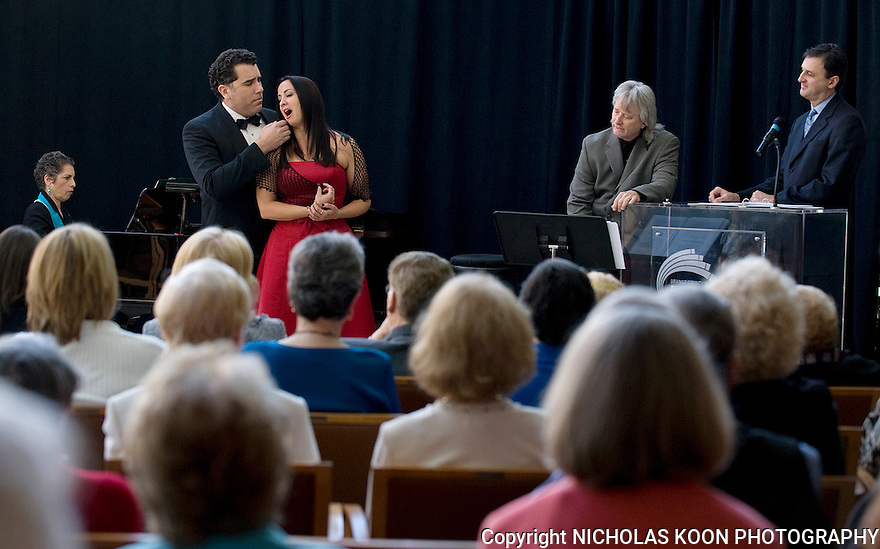 Soprano Shana Blake Hill and Tenor Omar Cook, accompanied by pianist Victoria H. Kirsch perform a piece from the opera La Boheme as Pacific Symphony Music Director Carl St. Clair and Director John Forsyte, and an audience of symphony supporters look on.  Opera will be part of the upcoming Pacific Symphony season.