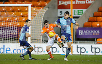Jack Redshaw of Blackpool between Max Muller (right) & Luke O'Nien of Wycombe Wanderers during the The Checkatrade Trophy match between Blackpool and Wycombe Wanderers at Bloomfield Road, Blackpool, England on 10 January 2017. Photo by Andy Rowland / PRiME Media Images.