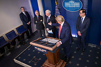 United States President Donald J. Trump invites Director of the National Institute of Allergy and Infectious Diseases at the National Institutes of Health Dr. Anthony Fauci, to deliver remarks on the COVID-19 (Coronavirus) pandemic in the Brady Press Briefing Room at the White House in Washington, DC, March 25, 2020, in Washington, D.C. Looking on from left center is US Vice President Mike Pence and from the right is US Secretary of the Treasury Steven T. Mnuchin.<br /> Credit: Sarah Silbiger / Pool via CNP/AdMedia