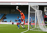 Luke Daniels of Scunthorpe Utd attempts to clear under pressure from Matt Done of Sheffield Utd during the English League One match at Glanford Park Stadium, Scunthorpe. Picture date: September 24th, 2016. Pic Simon Bellis/Sportimage