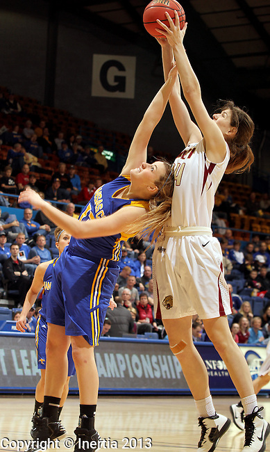 SIOUX FALLS, SD - MARCH 9:  Nevena Markovic #34 from IUPUI grabs a rebound over Taylor Leathers #13 from UMKC in the first half of their game Saturday afternoon during the women's Summit League Tournament at the Sioux Falls Arena. (Photo by Dave Eggen/Inertia)