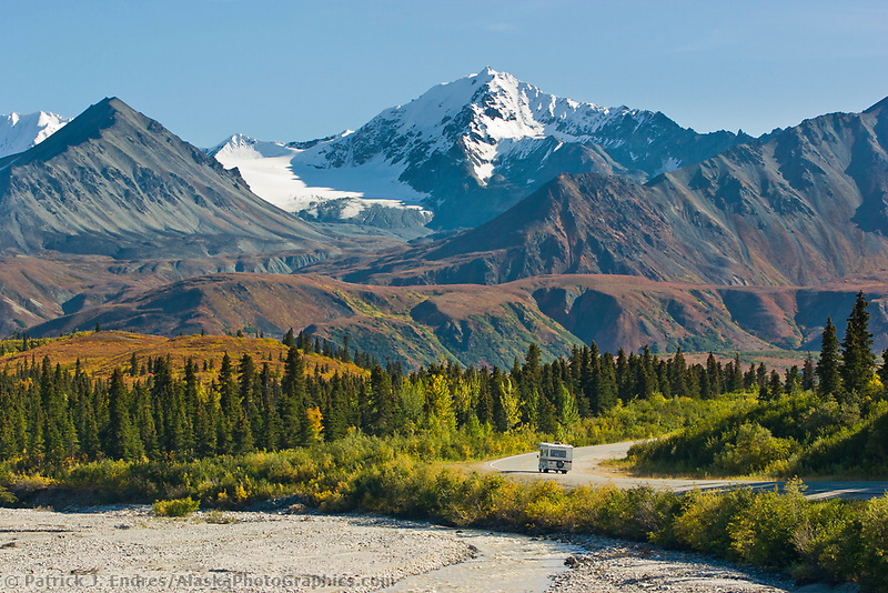 Motor home travels through the Alaska mountain range during autumn on the Richardson highway, Alaska