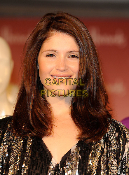 Gemma Arterton.opens the Harrods Summer Sale, Knightsbridge, London, England, UK,.18th June 2011..portrait headshot smiling beauty gold black sequined sequin .CAP/FIN.©Steve Finn/Capital Pictures.