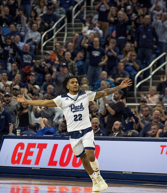 Nevada guard Jazz Johnson (22) reacts after making a three point shot against Utah State in the second half of an NCAA college basketball game in Reno, Nev., Wednesday, Jan. 2, 2019. (AP Photo/Tom R. Smedes)