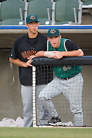 Madison Bumgarner (5) and Charlie Culberson (23) of the Augusta GreenJackets watch the action from the visitors dugout at Fieldcrest Cannon Stadium in Kannapolis, NC, Friday August 22, 2008. (Photo by Brian Westerholt / Four Seam Images)