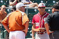 Oklahoma Sooners coach Sunny Golloway #29 meets with Texas Longhorns coach Augie Garrido before the NCAA baseball game on April 6, 2013 at UFCU DischFalk Field in Austin, Texas. The Longhorns defeated the rival Sooners 1-0. (Andrew Woolley/Four Seam Images).