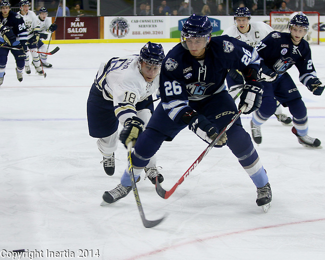 SIOUX FALLS, SD - OCTOBER 17:  Daniel Warpecha #18 from the Sioux Falls Stampede reaches for the puck past Mason Anderson #26 from the Madison Capitols in the first period Friday night at the Denny Sanford Premiere Center. (Photo/Dave Eggen/Inertia)