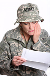 A USA military woman soldier reading a letter from home