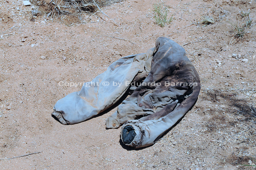 Sasabe, Arizona – This jacket was lying on the ground next to the path journalists walked during the Border Patrol event. The garment likely belonged to an immigrant or smuggle. U.S. Customs Border Protection (CBP) transported journalists to this remote area where they walked through a 1.3 miles trail during a two-day event organized by the Tucson Sector Border Patrol. The event brought national and international journalists to the Arizona desert to become acquainted with the dynamics of this area. This area is located near the Sasabe Port of Entry, a border-crossing station located in southern Arizona, and about 70 miles from the City of Tucson. Sasabe is one of the most isolated ports along the 2,000-mile U.S.-Mexico border, and it connects the towns of Sasabe, Arizona and El Sasabe, Sonora (Mexico). The border-crossing station is located in one of the busiest human and drug smuggling corridors of the U.S.-Mexico border. Photo by Eduardo Barraza © 2012