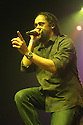 """Damian Marley performs during the """"Catch A Fire Tour 2015"""" stop at The Paramount in Huntington, Long Island on Tuesday, Sept. 1, 2015, in New York. (Photo by Donald Traill/Invision/AP)"""