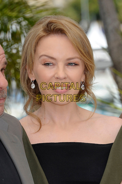 Kylie Minogue .'Holy Motors' photocall at the 65th  Cannes Film Festival, France..23rd May 2012.headshot portrait black  .CAP/PL.©Phil Loftus/Capital Pictures.