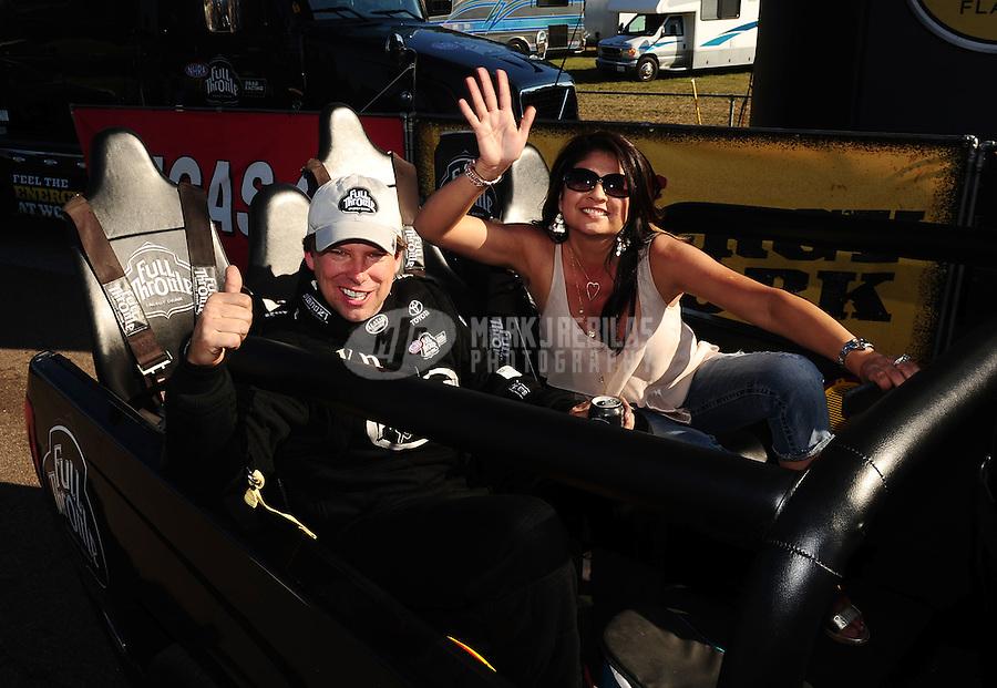 Mar. 13, 2011; Gainesville, FL, USA; NHRA top fuel dragster driver Del Worsham celebrates with wife Connie Worsham after winning the Gatornationals at Gainesville Raceway. Mandatory Credit: Mark J. Rebilas-