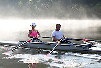 Former Marine sergeant Rob Jones and partner Oksana Masters row through the fog in a double scull boat while training on the Rivanna River Wednesday July, 25, 2012 in Charlottesville, VA. Former Marine sergeant Jones, who lost both legs during an IED explosion in Afghanistan, will compete with Masters as rowers at the 2012 Paralympics in London, England. Rowing will make its appearance at the London Paralympic Games for only the second time, after its introduction at the Beijing 2008 Games. Photo/Andrew Shurtleff