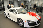 Matt Ross, Lou Wilson and Elena Champagne look at the Audi R8 at the grand opening celebration of Audi Central Houston Thursday March 6, 2014.(Dave Rossman photo)