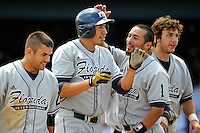 22 May 2010:  FIU's Rudy Flores (11, center) celebrates his sixth inning three-run home run with teammates (from left to right) Jeremy Patton (22), Michael Vargas (1) and Garrett Wittels (10) as the Florida Atlantic University Owls defeated the FIU Golden Panthers, 14-10, at FAU Stadium in Boca Raton, Florida.