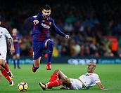 4th November 2017, Camp Nou, Barcelona, Spain; La Liga football, Barcelona versus Sevilla; Gerard Pique of FC Barcelona jumps the challenge