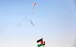 A kite laden with a molotov cocktail being flown by Palestinian protesters over the border with Israel before cutting the string across the fence, durin in a protest marking al-Quds Day, (Jerusalem Day), at the Israel-Gaza border in Khan Younis in the southern Gaza Strip on June 8, 2018. Photo by Ashraf Amra