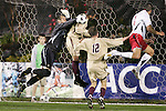 14 November 2008: Boston College's goalkeeper Chris Brown (left) punches a ball clear in the penalty area. The University of Maryland defeated Boston College 1-0 at WakeMed Stadium at WakeMed Soccer Park in Cary, NC in a men's ACC tournament semifinal game.