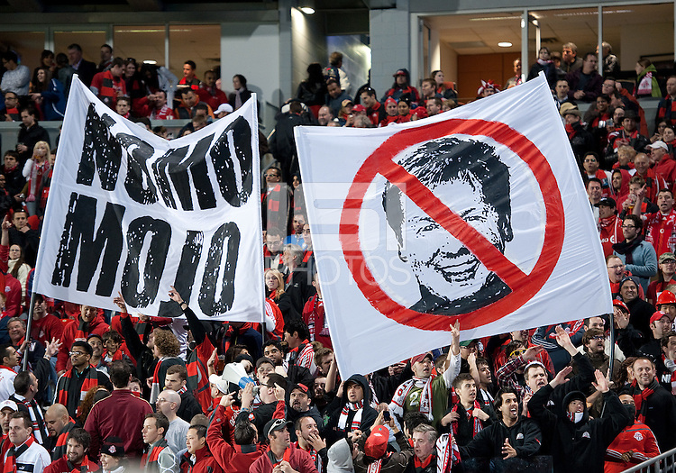 15 April 2010: The Toronto FC fans show their displeasure for Toronto FC manager Mo Johnson during a game between the Philadelphia Union and Toronto FC at BMO Field in Toronto..Toronto FC won 2-1..Photo by Nick Turchiaro/isiphotos.com........12 September 2009:Toronto FC forward Chad Barrett # 19 takes the ball up field during MLS action at BMO Field Toronto in a game between Colorado Rapids and Toronto FC. .Photo by Nick Turchiaro/isiphotos.comApril 12 2010: Chicago White Sox second baseman Gordon Beckham #15 and Chicago White Sox shortstop Omar Vizquel #11celebrate the win during the Toronto Blue Jays home opener between the Chicago White Sox and the Toronto Blue Jays at Rogers Centre in Toronto, Ontario..The White Sox won 8-7 in 11 innings.........11 April 2009:Toronto FC forward Chad Barrett # 19 takes the ball up field during MLS action at BMO Field Toronto, in a game between FC Dallas and Toronto FC. .Toronto FC won 2-1.