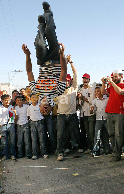 Palestinians perform a traditional dance as they protest and demanding the right of return for those who fled their homes during the 1948 war that followed the creation of Israel, in the west bank town of Halhoul, northern Hebron. The shirts are referring to the UN Resolution 194 that mainly deals with seeking a diplomatic solution to the conflict and Palestinian Arabs often repeat the claim of the right of return based on Resolution 194.