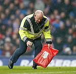 Steward on pitch to renove smokebomb