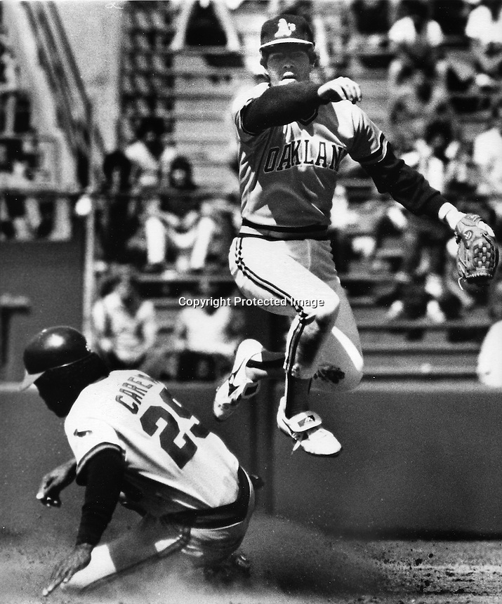 A's Donnie Hill forces Rod Carew at 2nd base..(photo by Ron Riesterer)