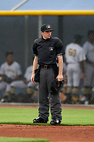 Umpire Trey Ward during a Gulf Coast League game between the GCL Pirates  and GCL Rays on August 7, 2019 at Charlotte Sports Park in Port Charlotte, Florida.  (Mike Janes/Four Seam Images)