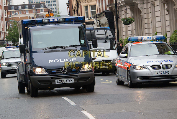 Michael Adebowale driven to Westminster Magistrates' Court, London, charged with the murder of soldier Lee Rigby, London, England.<br /> May 30th, 2013<br /> gv general view police car van traffic street road sirens <br /> CAP/BF<br /> &copy;Bob Fidgeon/Capital Pictures