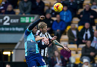 Aaron Pierre of Wycombe Wanderers battles Jonathan Stead of Notts Co during the Sky Bet League 2 match between Notts County and Wycombe Wanderers at Meadow Lane, Nottingham, England on 10 December 2016. Photo by Andy Rowland.