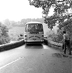The Beatles 1967 at start of Magical Mystery Tour, the bus gets stuck on a bridge.in Devon..© Chris Walter..