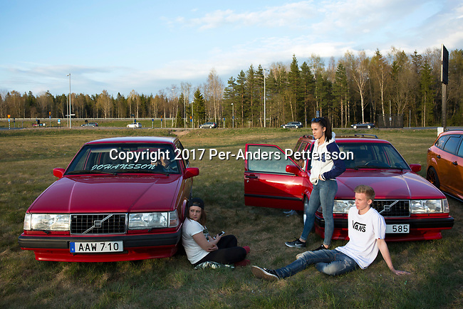 GISLAVED, SWEDEN - MAY 6: Swedish youth relax during a car meet, where new and old cars were displayed during a yearly meet on May 6, 2017 in Gislaved, Sweden. Many came from neighboring towns and cities, and these car meets are popular all over Sweden, and part of a car culture in the country.  (Photo by Per-Anders Pettersson/Getty Images)