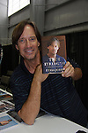 Actor Kevin Sorbo holds his new book True Strength in New York City, NY at the New York Comic Con. (Photo by Sue Coflin/Max Photos)