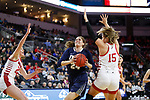 SIOUX FALLS, SD - MARCH 8: Montserrat Brotons #24 of Oral Roberts drives between South Dakota defenders Ciara Duffy #24 and Taylor Frederick #14  at the 2020 Summit League Basketball Championship in Sioux Falls, SD. (Photo by Richard Carlson/Inertia)