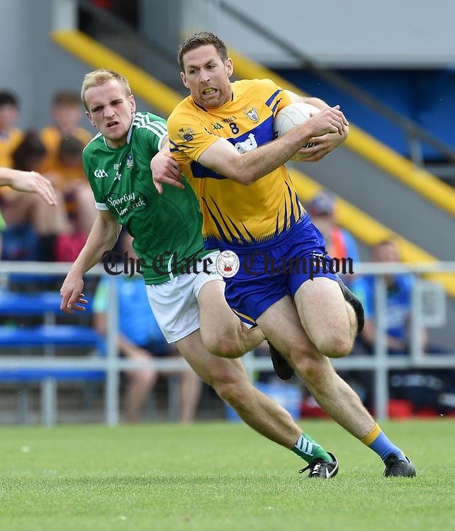 Gary Brennan of Clare in action against Sean O Dea of Limerick during their Munster championship quarter-final game in Cusack park. Photograph by John Kelly.