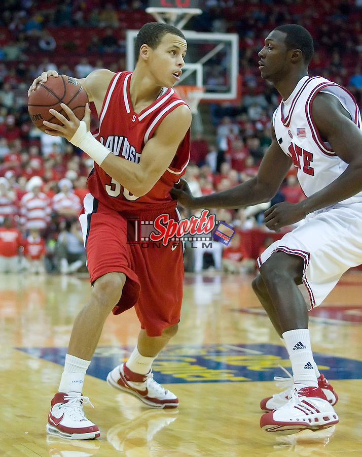 Davidson's Stephen Curry (30) is defended by North Carolina State's Courtney Fells (4) during first half action versus the North Carolina State Wolfpack at the RBC Center in Raleigh, NC, Friday, December 21, 2007.  The Wolfpack defeated the Wildcats 66-65.