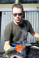 A craftsman gives a glass blowing demonstration at the National Glass Centre in Sunderland, Great Britain